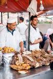 Уличный рынок - поставщики мяса стоковые изображения