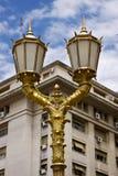 уличный фонарь золота и дворец Стоковое Изображение