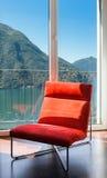 Удобное красное кресло Стоковое Фото