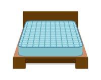 Удобный тюфяк для спать на кровати Стоковые Изображения RF
