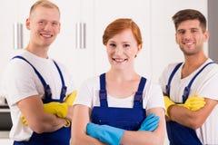 Удовлетворенная команда уборщиков стоковое фото