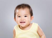 Улыбка младенца стоковое изображение rf