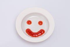 Улыбка от кетчуп томата. Стоковые Фото