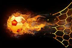 Файрбол футбола ведет счет цель на сети стоковое фото