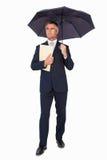 Файл удерживания бизнесмена под зонтиком Стоковая Фотография RF