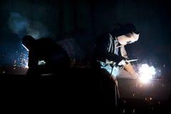 факелы сваривая работников Стоковое Изображение