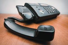 Факс с выбранной вверх телефонной трубкой стоковое изображение
