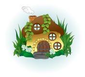 Фантастический дом гриба с круглыми окнами среди травы бесплатная иллюстрация