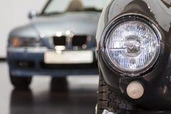 Фара автомобиля на заднем плане автомобиля Стоковое Изображение