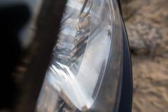 Фара от автомобиля как абстрактная предпосылка Стоковое фото RF
