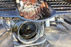 Фара современного крупного плана автомобиля Стоковые Фотографии RF