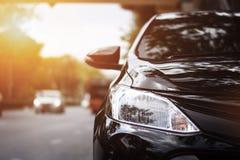 Фары крупного плана черного автомобиля Стоковая Фотография