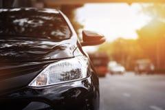 Фары крупного плана черного автомобиля Стоковое фото RF
