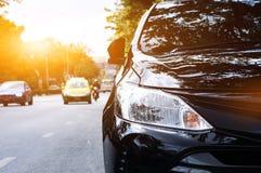 Фары крупного плана черного автомобиля Стоковая Фотография RF