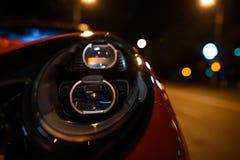 Фары СИД автомобилей нового поколения на ноче Стоковое фото RF