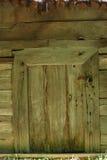 Фасад старого рахитичного деревянного здания Стоковые Фотографии RF