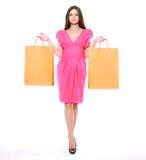 фасонируйте покупку девушки Женщина красоты с хозяйственными сумками Стоковое фото RF