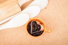 Фасоль чашки кофе и резец печений Стоковые Изображения