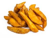 Фаст-фуд, куски картошки на белой предпосылке Стоковые Изображения