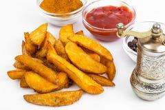 Фаст-фуд, куски картошки на белой предпосылке Стоковые Фотографии RF
