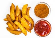 Фаст-фуд, куски картошки на белой предпосылке Стоковое Изображение RF