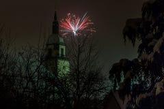 Фейерверки и башня церков Стоковые Фотографии RF