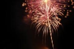 Фейерверки на темноте Стоковое Фото