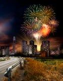 Фейерверк над городом стоковые фото