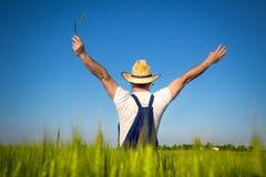 Фермер в поле Стоковые Фото