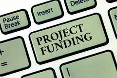 Финансирование проектов текста почерка Смысл концепции оплачивая для начинает вверх в заказе сделать его большой и успешный стоковые фото
