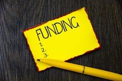 Финансирование сочинительства текста почерка Концепция знача деньги обеспеченные правительством организации для определенной цели стоковые фото