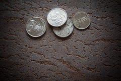 Финансовый кризис, монетки Стоковое фото RF