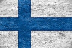 Финский флаг над старой стеной Стоковое Изображение RF