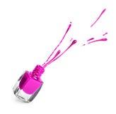 Фиолетовая бутылка маникюра с выплеском Стоковое Изображение
