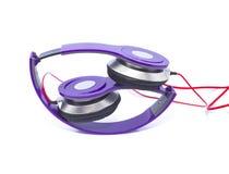 Фиолетовые наушники Стоковые Изображения