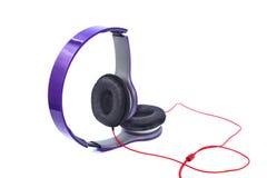 Фиолетовые наушники Стоковые Фотографии RF