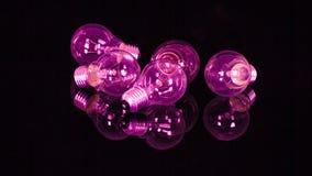 Фиолетовые электрические лампочки Стоковое Фото