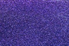 Фиолетовые sequins shine порошок glitter предпосылка светя стоковые изображения