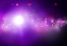 Фиолетовый луч освещает bokeh Стоковая Фотография RF