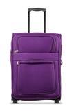 Фиолетовый чемодан изолированный на белой предпосылке Стоковые Фото