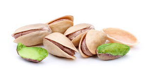 фисташка предпосылки близкая nuts вверх по белизне Стоковые Изображения