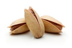 фисташка предпосылки близкая nuts вверх по белизне Стоковая Фотография