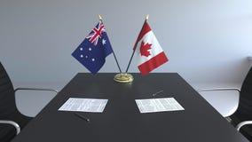 Флаги Австралии и Канады и бумаги на таблице Переговоры и подписание международного соглашения схематическо бесплатная иллюстрация