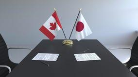 Флаги Канады и Японии и бумаги на таблице Переговоры и подписание международного соглашения Схематическое 3D иллюстрация вектора