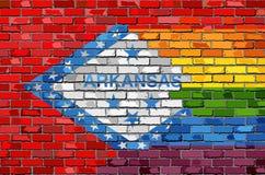 Флаги кирпичной стены Арканзаса и гомосексуалиста Стоковое Изображение RF