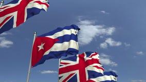 Флаги Кубы и Великобритании против голубого неба, loopable 3D анимации акции видеоматериалы