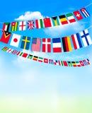 Флаги овсянки мира на голубом небе Стоковое Изображение