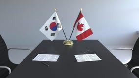 Флаги Южной Кореи и Канады и бумаги на таблице Переговоры и подписание международного соглашения схематическо бесплатная иллюстрация
