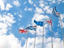 Флаги Georgia, Adjara и Европейского союза на голубом небе стоковая фотография rf