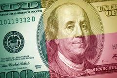 Флаг Бенина на американской предпосылке денег доллара стоковое фото rf